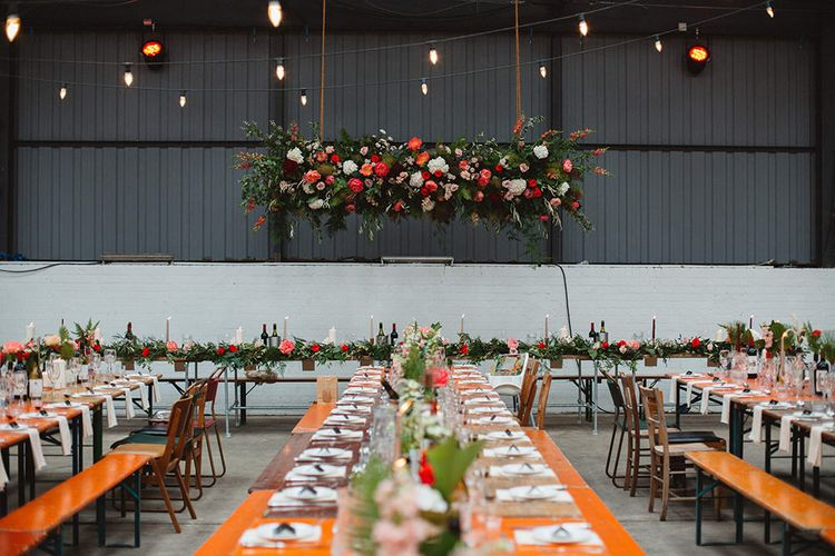 Red, Pink & Foliage Hanging Floral Installation | Wedding Reception Decor | Contemporary Wedding at Industrial Venue 92 Burton Road, Sheffield | Maytree Photography