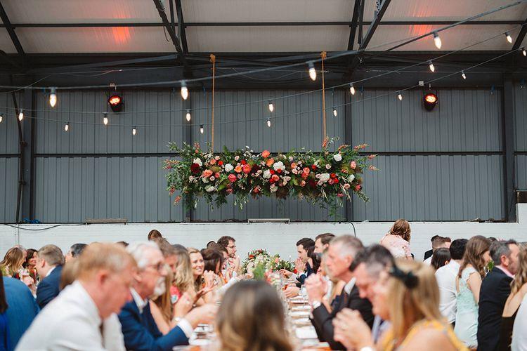 Industrial Wedding Reception | hanging Flower Installation | Contemporary Wedding at Industrial Venue 92 Burton Road, Sheffield | Maytree Photography