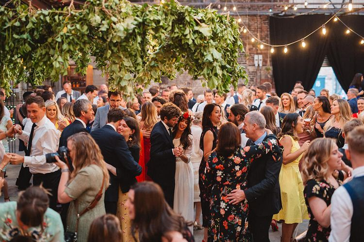First Dance | Boho Bride in Laure De Sagazan Baudelaire Bridal Gown and Flower Crown | Groom in Navy Reiss Suit | Contemporary Wedding at Industrial Venue 92 Burton Road, Sheffield | Maytree Photography