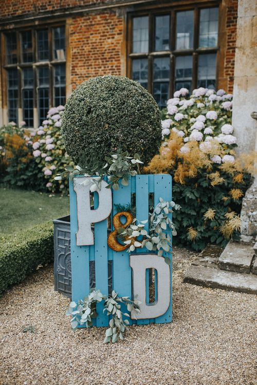 Wooden Palette Sign For Wedding // Vow Renewal At Doddington Hall With Bride In Alan Hannah With Brightly Coloured Florals And Images From Magda K Photography