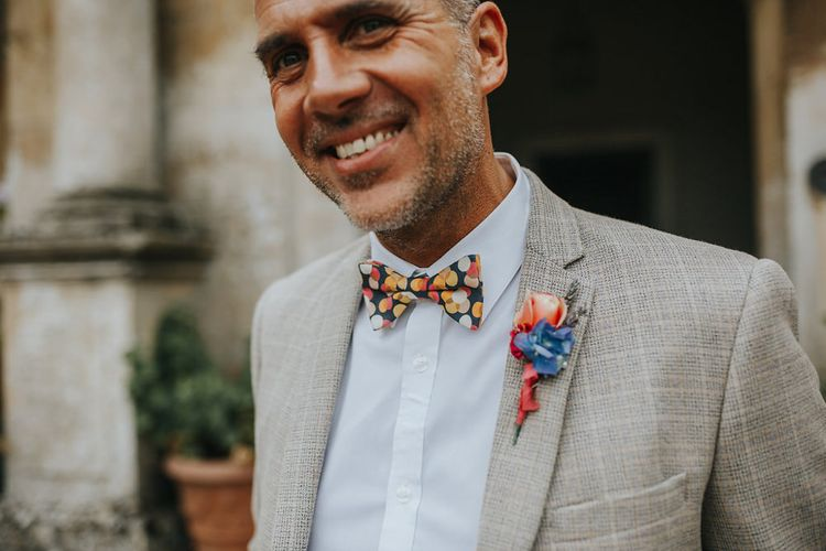 Groom In Light Grey Checked Suit // Vow Renewal At Doddington Hall With Bride In Alan Hannah With Brightly Coloured Florals And Images From Magda K Photography