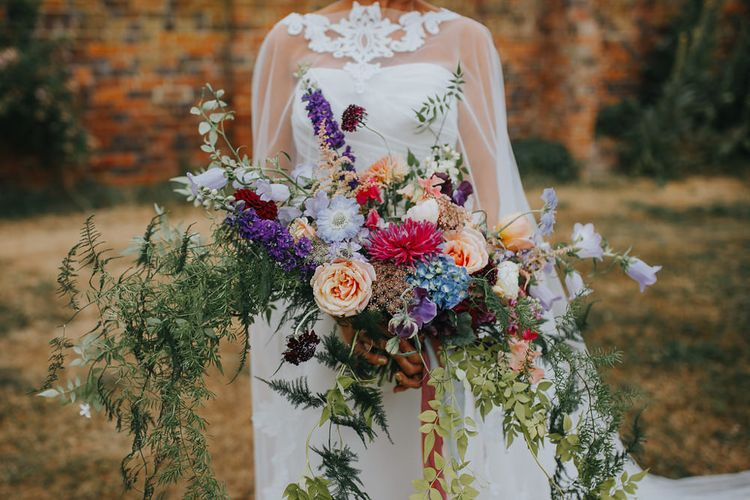 Oversized Wedding Bouquet // Vow Renewal At Doddington Hall With Bride In Alan Hannah With Brightly Coloured Florals And Images From Magda K Photography
