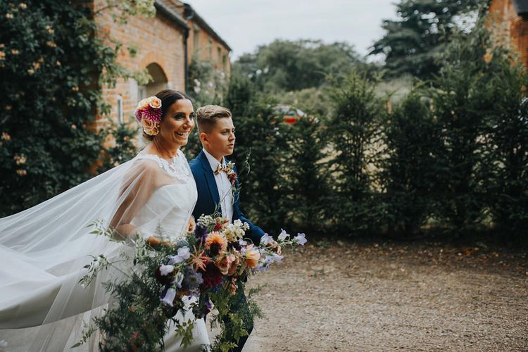 Bride In Alan Hannah With Oversized Wedding Bouquet // Vow Renewal At Doddington Hall With Bride In Alan Hannah With Brightly Coloured Florals And Images From Magda K Photography