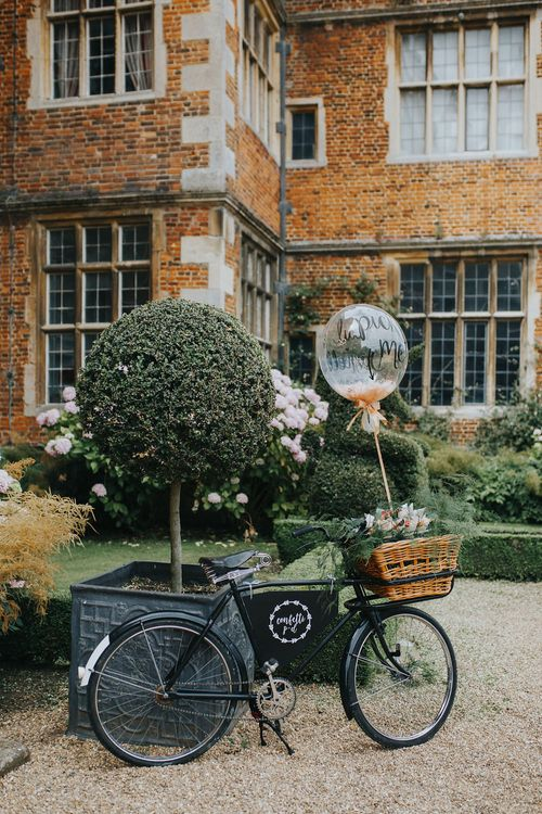 Vintage Bicycle Wedding Decor // Vow Renewal At Doddington Hall With Bride In Alan Hannah With Brightly Coloured Florals And Images From Magda K Photography