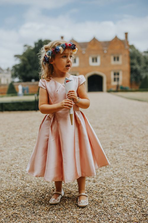 Flower Girl In Pink Dress // Vow Renewal At Doddington Hall With Bride In Alan Hannah With Brightly Coloured Florals And Images From Magda K Photography