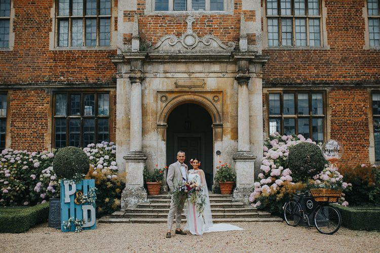 Vow Renewal At Doddington Hall With Bride In Alan Hannah With Brightly Coloured Florals And Images From Magda K Photography