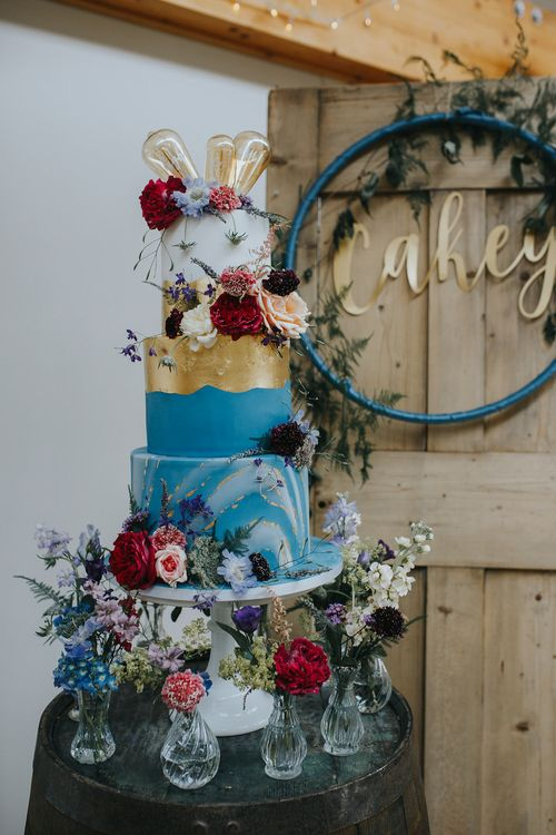 Bright Blue And Gold Wedding Cake // Vow Renewal At Doddington Hall With Bride In Alan Hannah With Brightly Coloured Florals And Images From Magda K Photography