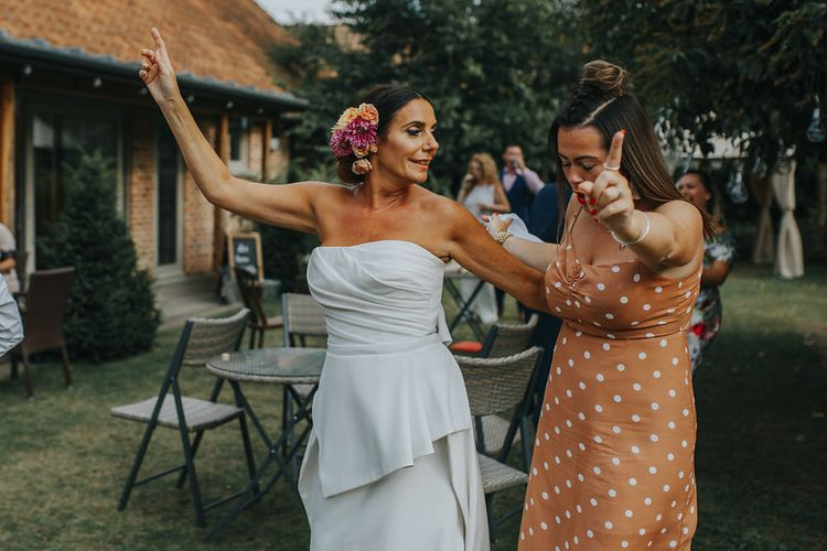 Wedding Party Conga // Vow Renewal At Doddington Hall With Bride In Alan Hannah With Brightly Coloured Florals And Images From Magda K Photography