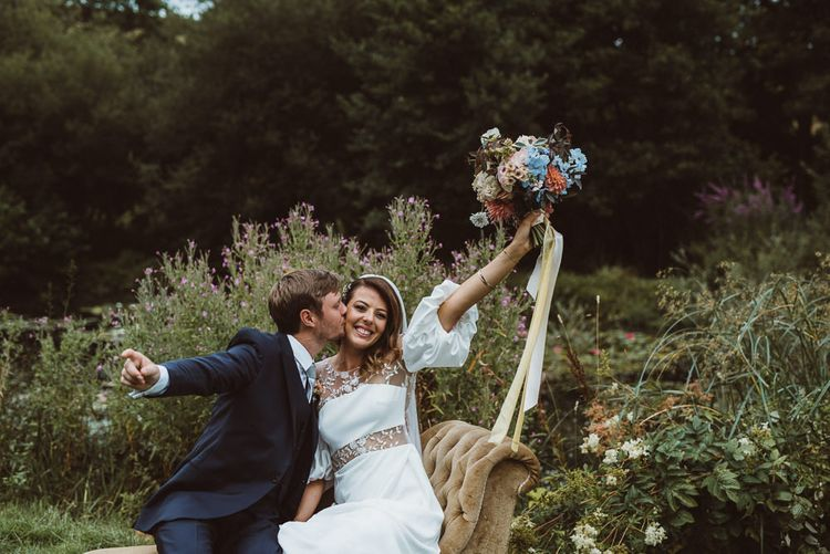 Bride in Rime Arodaky Wedding Dress and Groom is Reiss Suit at Outdoor Wedding Ceremony