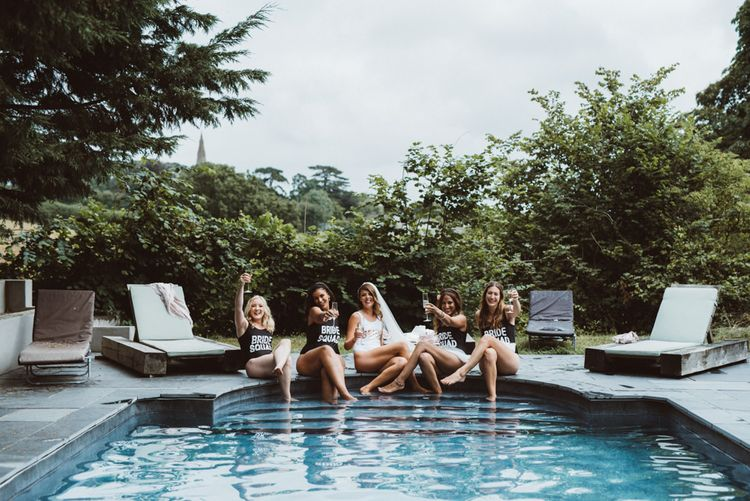 Bridal Party Hanging Out By The Pool in Bridal Squad Swimsuits