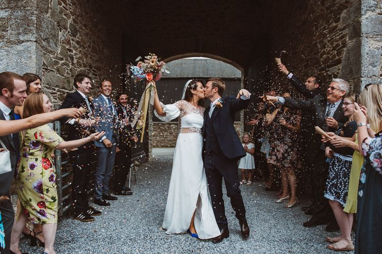 Confetti Moment with Bride in Rime Arodaky Wedding Dress and Groom is Reiss Suit