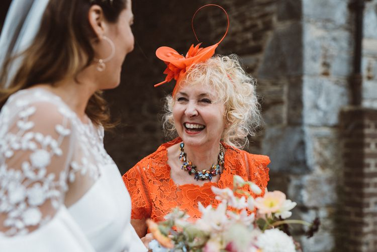 Wedding Guest Laughing with Bride