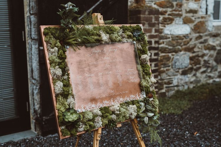 Wood and Moss Seating Chart on an Easel