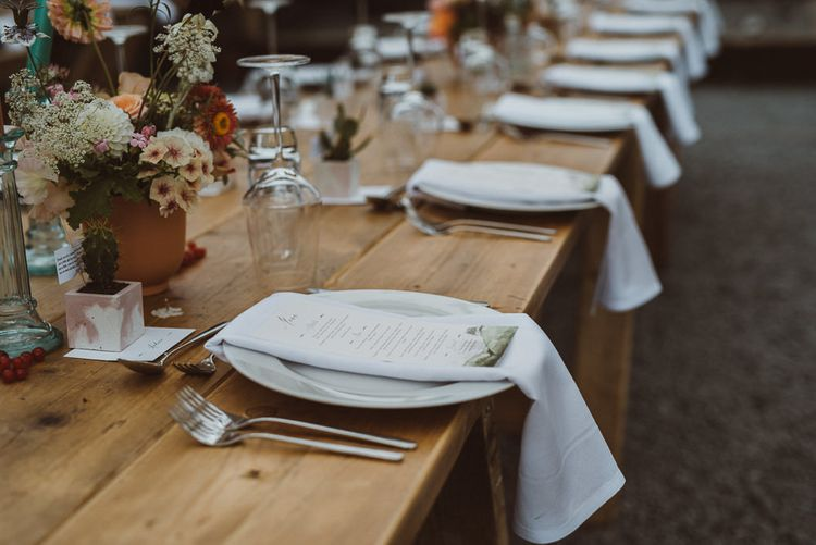 Place Setting with Linen Napkins and Menu Cards