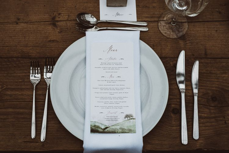 Place Setting with White Napkin and Menu Card