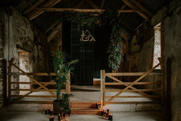 Foliage & Candle Light Altar Wedding Decor | Forest Green and Black Dark Decadence Wedding Inspiration in a Rustic Barn Planned & Styled by Knots & Kisses with Images by Daze of Glory Photography
