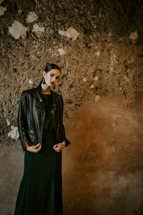 Bride in Black Dress & Leather Jacket | Forest Green and Black Dark Decadence Wedding Inspiration in a Rustic Barn Planned & Styled by Knots & Kisses with Images by Daze of Glory Photography