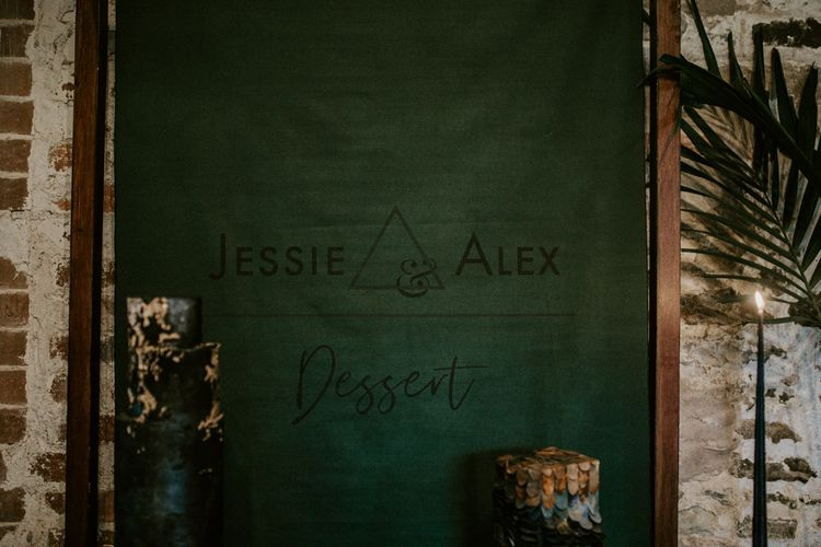 Forest Green Flag Backdrop with Geometric Design | Forest Green and Black Dark Decadence Wedding Inspiration in a Rustic Barn Planned & Styled by Knots & Kisses with Images by Daze of Glory Photography