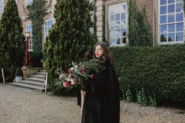 Bride in Black River Elliot Bridal Gown & Cape | Dark Opulence Inspiration at Anstey Hall, Cambridgeshire Styled by Mia Sylvia | Camilla Andrea Photography