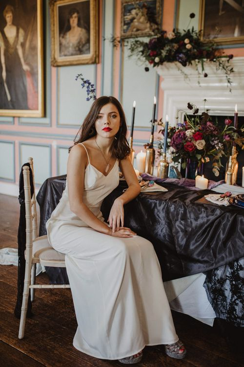 Bride in River Elliot Bridal Gown | Tablescape with Candlesticks  | Dark Opulence Inspiration at Anstey Hall, Cambridgeshire Styled by Mia Sylvia | Camilla Andrea Photography