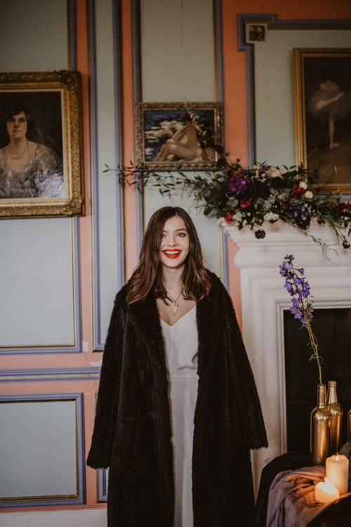 Bride in River Elliot Bridal Gown and Fur Coat | Tablescape with Candlesticks  | Dark Opulence Inspiration at Anstey Hall, Cambridgeshire Styled by Mia Sylvia | Camilla Andrea Photography