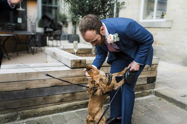 Groom in Navy Suit and Pet Dog
