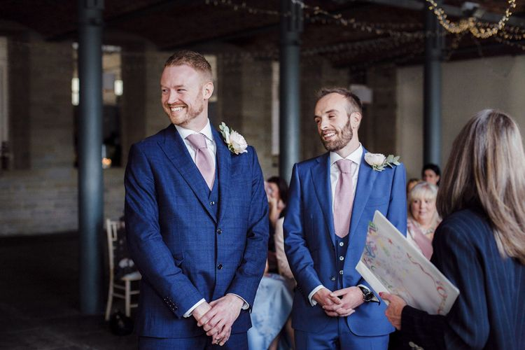 Wedding Ceremony with Two Grooms in Navy Blue Suits