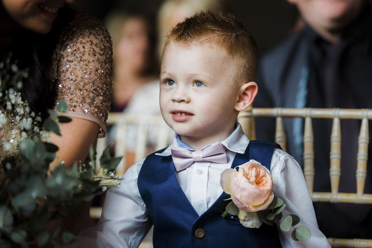 Page Boy in Navy Waistcoat and Rose Buttonhole