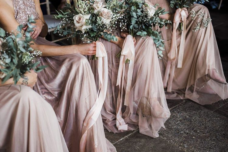 Bridesmaids in Blush Pink Sequins and Tulle Maya Dresses Sitting at the Wedding Ceremony
