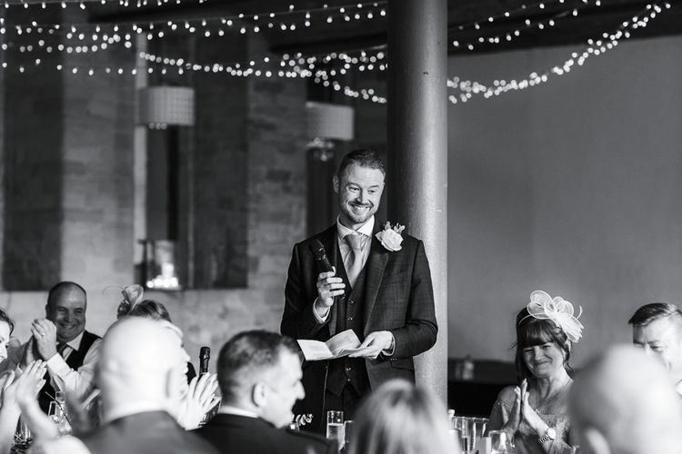 Wedding Reception Grooms Speech with Hanging Lights