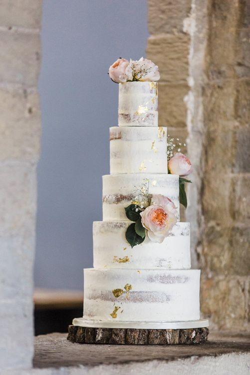 Five Tier Semi Naked Wedding Cake on Tree Slice Cake Stand
