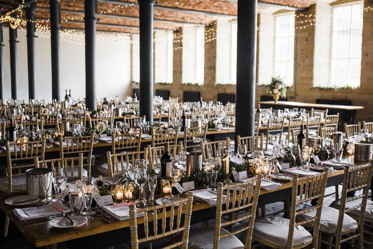Industrial Wedding Reception with String Lights and Greenery Garland Centrepiece
