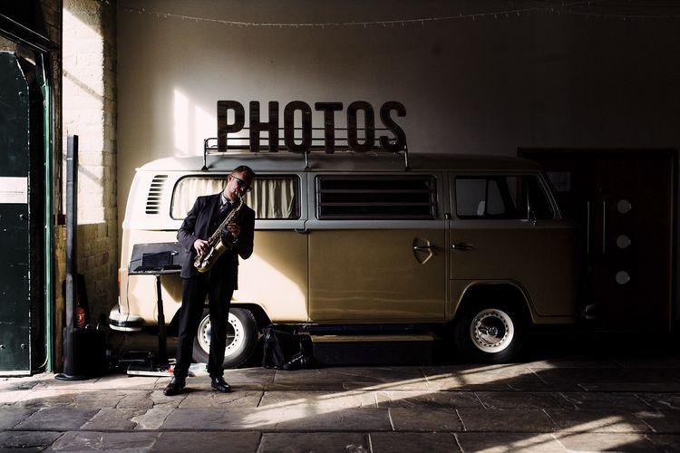 Saxophonist Standing in Front of VW Camper Van Photo Booth