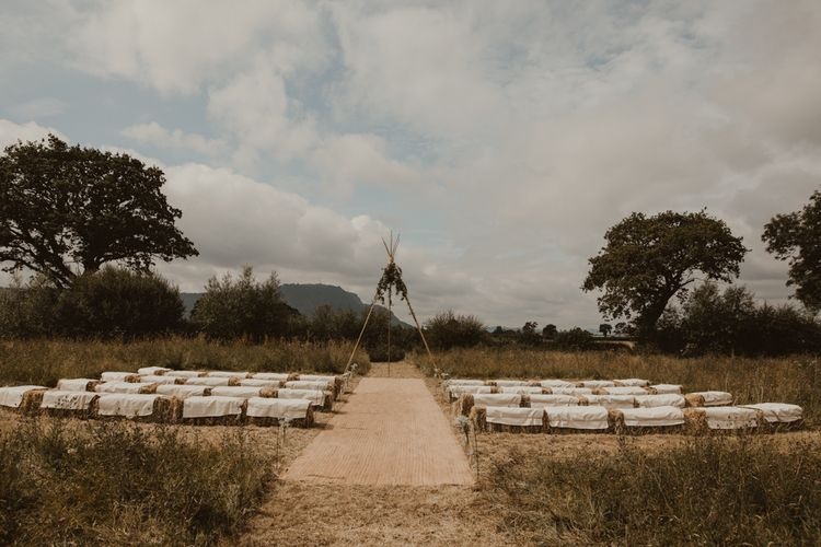 Naked Tipi at Sychpwll Centre in Wales   Hay Bales with White Blankets   Hessian Aisle   Yurt Wedding with Outdoor Naked Tipi Ceremony, Glitter Station & Peach Rewritten Bridesmaid Dresses   Nesta Lloyd Photography