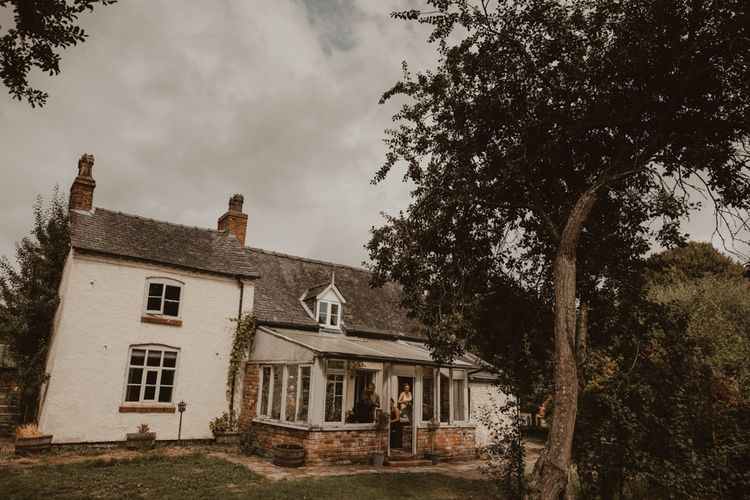 17th Century Farmhouse at Sychpwll Centre in Wales   Bridal Party Getting Ready   Yurt Wedding with Outdoor Naked Tipi Ceremony, Glitter Station & Peach Rewritten Bridesmaid Dresses   Nesta Lloyd Photography