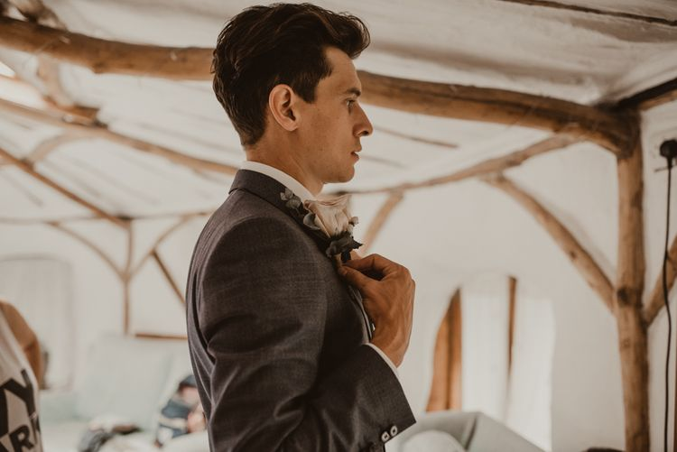 Groom in Light Blue Two-Piece Suit by Hugo Boss   Blush Pink Buttonhole   Yurt Wedding with Outdoor Naked Tipi Ceremony, Glitter Station & Peach Rewritten Bridesmaid Dresses   Nesta Lloyd Photography