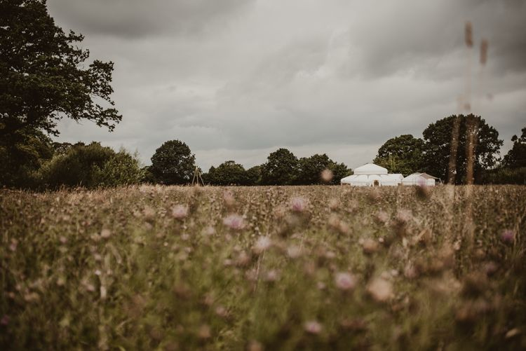 Wedding Yurt in 5 Acre Wildflower Meadow at Sychpwll Centre in Wales   Yurt Wedding with Outdoor Naked Tipi Ceremony, Glitter Station & Peach Rewritten Bridesmaid Dresses   Nesta Lloyd Photography