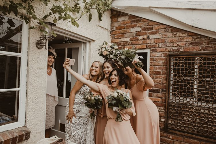 Bride in Sasha Dress by Made With Love with Crochet Finish, Fishtail Train, V-Neck and Plunging Back   Bridesmaids in Mismatched Peach Rewritten Dresses, Tops and Skirts   Wedding Bouquets of Blush and White Roses, Gypsophila and Eucalyptus   Yurt Wedding with Outdoor Naked Tipi Ceremony, Glitter Station & Peach Rewritten Bridesmaid Dresses   Nesta Lloyd Photography