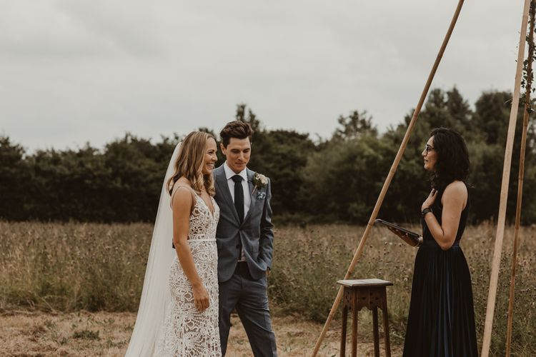 Bride in Sasha Dress by Made With Love with Crochet Finish, Fishtail Train, V-Neck and Plunging Back   Groom in Light Blue Two-Piece Suit by Hugo Boss   Blush Pink Buttonhole   Yurt Wedding with Outdoor Naked Tipi Ceremony, Glitter Station & Peach Rewritten Bridesmaid Dresses   Nesta Lloyd Photography