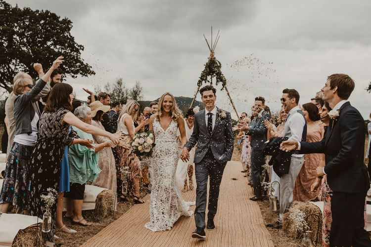 Bride in Sasha Dress by Made With Love with Crochet Finish, Fishtail Train, V-Neck and Plunging Back   Bridal Bouquet of Blush and White Roses, Gypsophila and Eucalyptus   Groom in Light Blue Two-Piece Suit by Hugo Boss   Blush Pink Buttonhole   Hessian Aisle   Hay Bales with White Blankets   Yurt Wedding with Outdoor Naked Tipi Ceremony, Glitter Station & Peach Rewritten Bridesmaid Dresses   Nesta Lloyd Photography