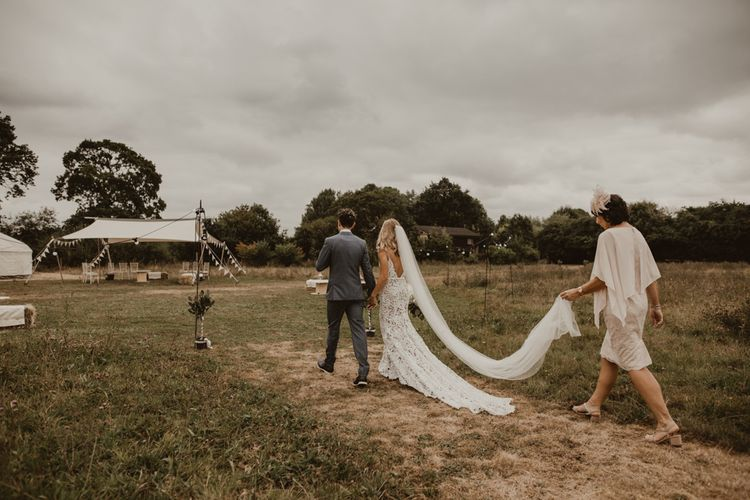Bride in Sasha Dress by Made With Love with Crochet Finish, Fishtail Train, V-Neck and Plunging Back   Groom in Light Blue Two-Piece Suit by Hugo Boss   Yurt Wedding with Outdoor Naked Tipi Ceremony, Glitter Station & Peach Rewritten Bridesmaid Dresses   Nesta Lloyd Photography