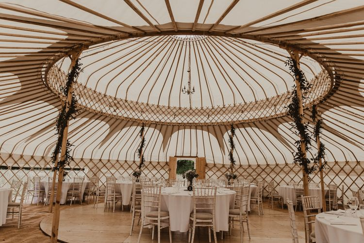 Yurt Wedding Reception at Sychpwll Centre in Wales   Foliage Wrapped Around Poles   Fairy Lights   Yurt Wedding with Outdoor Naked Tipi Ceremony, Glitter Station & Peach Rewritten Bridesmaid Dresses   Nesta Lloyd Photography