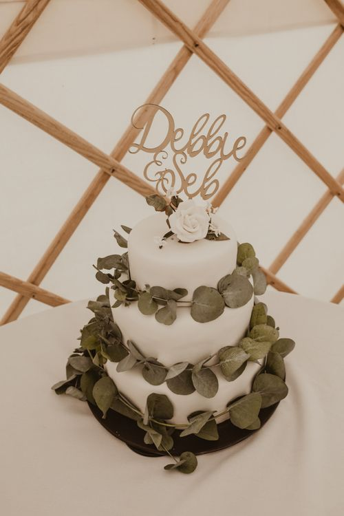 Homemade Three-Tier Iced Fruit Cake Wrapped with Eucalyptus   Laser Cut Cake Topper   Yurt Wedding with Outdoor Naked Tipi Ceremony, Glitter Station & Peach Rewritten Bridesmaid Dresses   Nesta Lloyd Photography