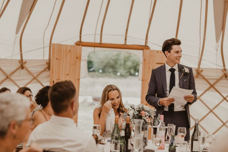 Bride in Sasha Dress by Made With Love with Crochet Finish, Fishtail Train, V-Neck and Plunging Back   Groom in Light Blue Two-Piece Suit by Hugo Boss   Blush Buttonhole   Yurt Wedding with Outdoor Naked Tipi Ceremony, Glitter Station & Peach Rewritten Bridesmaid Dresses   Nesta Lloyd Photography