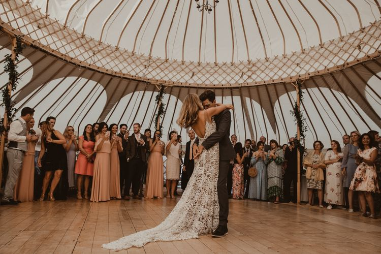 Bride in Sasha Dress by Made With Love with Crochet Finish, Fishtail Train, V-Neck and Plunging Back   Groom in Light Blue Two-Piece Suit by Hugo Boss   Bridesmaids in Mismatched Peach Rewritten Dresses, Tops and Skirts   First Dance in Yurt at Sychpwll Centre   Yurt Wedding with Outdoor Naked Tipi Ceremony, Glitter Station & Peach Rewritten Bridesmaid Dresses   Nesta Lloyd Photography
