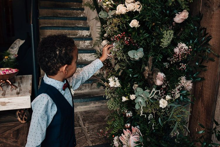 Little wedding guest admiring the wedding flowers by Leafy Couture