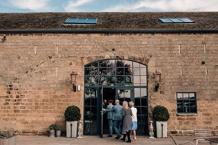 Groom welcoming wedding guests to Wharfedale Grange wedding ceremony