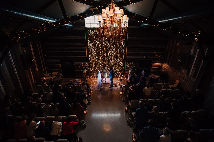 Wedding ceremony at Wharfedale Grange with fairy light backdrop