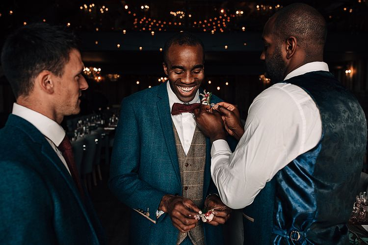 Groom Marc Darcy suit and bow tie