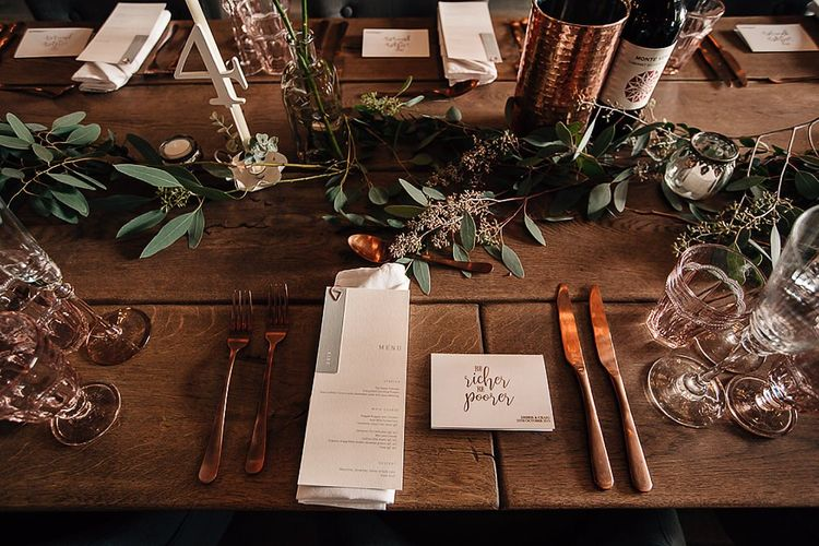 Place setting with copper cutlery and menu card